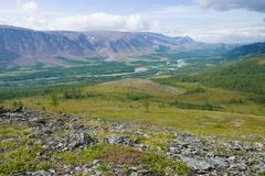 Sunny day in mountains of Polar Ural. View of the valley of the Sob river. Sunny August day in mountains of Polar Ural. View of the valley of the Sob river royalty free stock images
