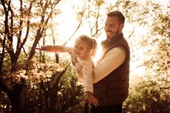 Sunny day in nature. Father and daughter. stock photos