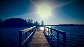Sunny day. Old Log Dock Soaked in Sun Royalty Free Stock Photos