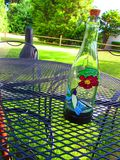 A Sunny Day Outside. A glass bottle outside on a summer day Stock Image