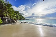 Sunny day on paradise beach anse georgette,praslin seychelles 7. Sunny day on paradise beach with big granite rocks, turquoise water, white sand and palm trees Stock Photos