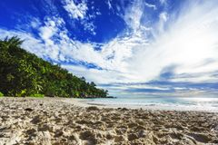 Sunny day on paradise beach anse georgette,praslin seychelles 2. Sunny day on paradise beach with big granite rocks, turquoise water, white sand and palm trees Stock Image