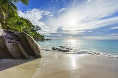 Sunny day on paradise beach anse georgette,praslin seychelles 9. Sunny day on paradise beach with big granite rocks, turquoise water, white sand and palm trees Royalty Free Stock Photos