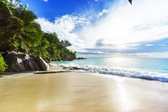 Sunny day on paradise beach anse georgette,praslin seychelles 7. Sunny day on paradise beach with big granite rocks, turquoise water, white sand and palm trees Stock Photography