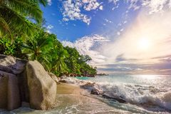 Sunny day on paradise beach anse georgette,praslin seychelles 18. Sunny day on paradise beach with big granite rocks, turquoise water, white sand and palm trees royalty free stock photography