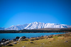 Sunny day at paradise places in South New Zealand / Lake Tekapo / Church of the Good Shepherd. Lake Tekapo is a lakeside resort village in the Mackenzie Country Royalty Free Stock Image