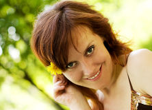Sunny day portrait. Portrait of a young smiling woman walking in the park Royalty Free Stock Image