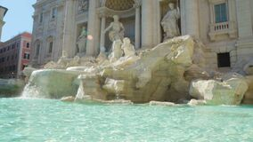 Sunny day in Rome, antique architecture of Trevi fountain, touristic sight. Stock footage stock video