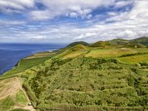 Sunny day in Sao Miguel. Aerial view of crops and the ocean on the Azorean Island of Sao Miguel in Portugal royalty free stock photos