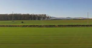Sunny day spain field train ride window view 4k. Spain sunny day field train ride window view 4k stock video footage