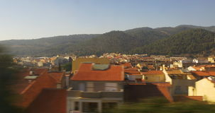 Sunny day spain town train ride window view 4k spain. Sunny day town train ride window view 4k spain stock video