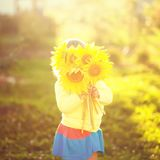 Happy child with bouquet of beautiful sunflowers. Sunny day, summer vacation. cute happy little girl with yellow sunflowers, outdoor portrait, instagram photo stock images
