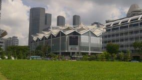 Sunny day suntec city mall crossroad war memorial park panorama singapore stock video