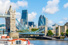 Sunny Day at Tower Bridge. Sunny day at the Tower Bridge and financial district of London Royalty Free Stock Photo