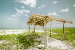 Sunny day at tropical beach with fisherman hut. Myanmar (Burma) Stock Image