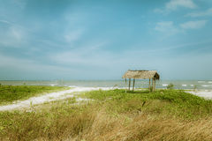 Sunny day at tropical beach with fisherman hut. Myanmar (Burma) Stock Photography