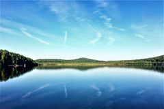 Sunny day in the Urals lake and blue sky royalty free stock images