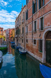 Sunny day in Venice, Italy. Blue sky and Canal with boats in Venice, Italy Stock Image