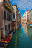 Sunny Day in Venice, Italy. Blue sky and Grand Canal with boats and gondola in Venice, Italy Stock Photos