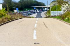 Sunny day view empty UK motorway junction shoulder stock images