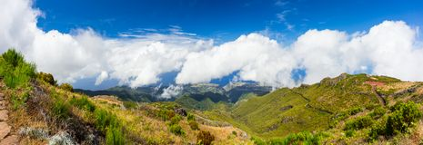 Sunny day view fom Pico de Arieiro over the vast luscious green. View fom Pico de Arieiro over the vast luscious green landscape of Madeira Island, Portugal Stock Photos