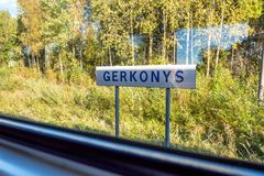 Sunny day view of Gerkonys town nameplate through train window traveling from visaginas to vilnius lithuania stock photography
