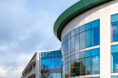 Sunny day view of windows of modern business corporate office building in northampton england uk.  stock image