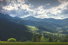 Sunny day for a walk in the mountains. A good summer day for traveling in the mountains. A sunny day in the mountains Stock Images
