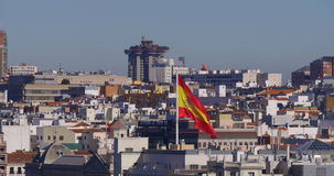 Sunny day warm wind spain national flag waving 4k madrid stock video footage