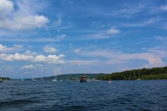 A sunny day on the water in Baddeck harbor with sailboats Stock Photography
