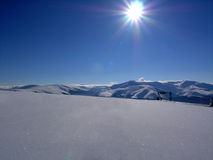 Sunny day - winter. Snow and blue sky mountains panorama Stock Photos