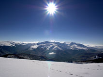 Sunny day - winter. Snow and blue sky mountains panorama Royalty Free Stock Photography