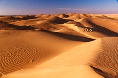 Sunny desert scenery. Sand pattern, lights and shadows stock photo