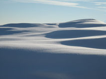 Sunny dunes of freshly snow Stock Photo