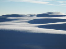 Sunny dunes of freshly snow Stock Photography