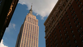 Sunny empire state building 4k time lapse from new york