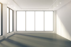 Sunny empty room with windows in floor and white walls. Close up Royalty Free Stock Image