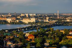 Sunny evening summer Voronezh, aerial view. Voronezh water reservoir, bridge, old and modern buildings Stock Photography
