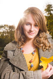 Sunny fall dashion woman. Stock Image