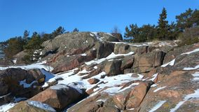 Sunny February day on the rocks of the Hanko Peninsula. Finland. Sunny February day on the rocks of the Hanko Peninsula, Finland stock video footage