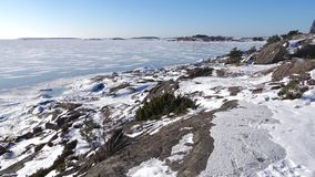 Sunny february day on the shore of the Hanko Peninsula. Finland. Sunny february day on the shore of the Hanko Peninsula, Finland stock footage