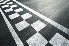 Sunny finish line racing background. Sunny finish and start pattern line on the asphalt race road stock photos