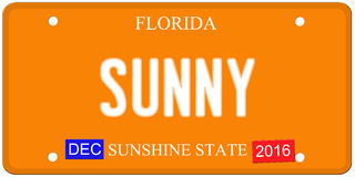 Sunny Florida License Plate. An imitation Florida license plate with December 2016 stickers and SUNNY written on it making a great concept.  Words on the bottom Royalty Free Stock Photo