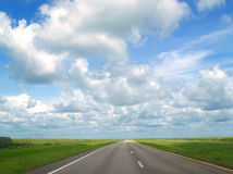Sunny Florida Road. A sunny road with many clouds in Florida Stock Images