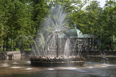 Sunny fountain in the park Stock Image