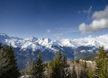 Sunny french alps mountain snow view in les arcs france Royalty Free Stock Image