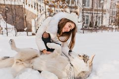 Free Sunny Frozen Morning Of Fashionable Enjoyed Young Woman Playing With Husky Dog In Snow Outdoor. Lovely Moments, True Royalty Free Stock Images - 146863449
