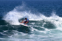 Sunny Garcia surfing in the Triple Crown Hawaii Stock Photo
