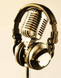 Sunny Gear. (Sun Glints on Professional Headphones and Vintage Microphone Royalty Free Stock Image
