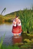 Sunny girl. In rashy lake royalty free stock photos